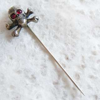 cross bones stick pin from the early part of the 20th century red gem