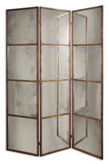 metal frame finished in heavily antiqued gold. Mirrors are antiqued